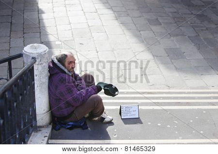 Beggar Sitting On Stairs In Venice