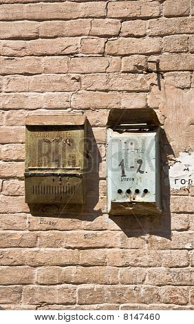 Old brick wall with mailboxes