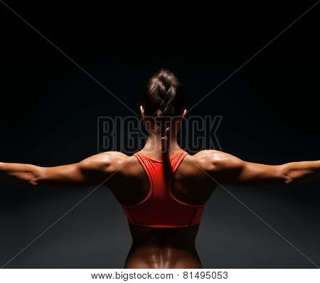 Athletic Young Woman Showing Muscles Of The Back