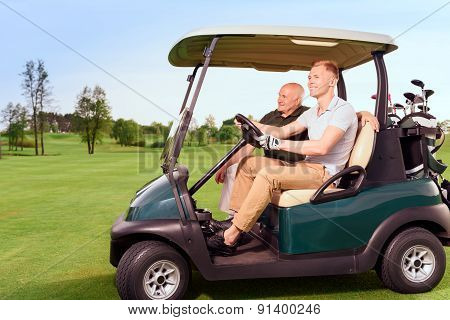 Side view of two golfer driving cart