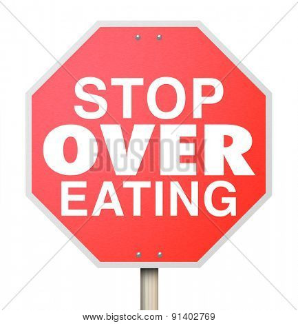Stop Over Eating words on a red road sign as warning to reduce food intake, pay attention to good nutrition and consume smaller portion sizes