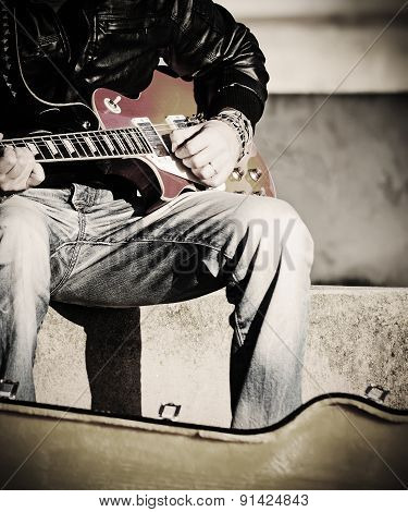 Close Up Of A Guitarist Playing In Vintage Effect