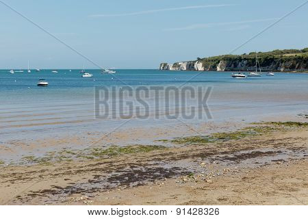 A Photo Taken On A Spring Day At Swanage Beach Looking Towards The Boats On The Sea And The Jurasic