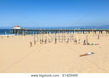 People Play Volleyball And Train At The Beach
