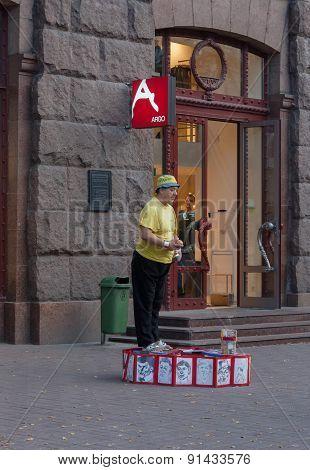 Kiev, Ukraine - September, 11,2013: Elderly Clown Entertains Residents And Tourists Near The Indepen