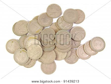 Bunch of old Spanish coins of 5 pesetas showing Franco face isolated on a white background. 1957