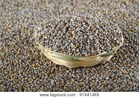 Bajra (Pearl millet) in wooden(bamboo) basket