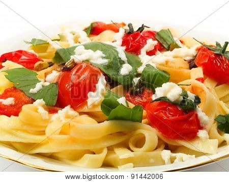 Fettucini prepared with fried cherry tomatoes basil and mozarella poster