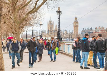 Thames Riverbank Crowded With People In London