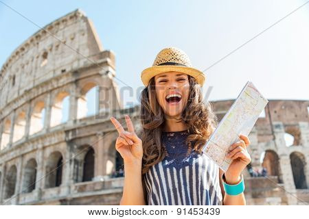 Woman Making Victory Sign In Rome Near Colosseum Holding Map