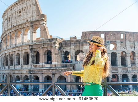 Woman Standing Near Colosseum In Rome Listening To Music