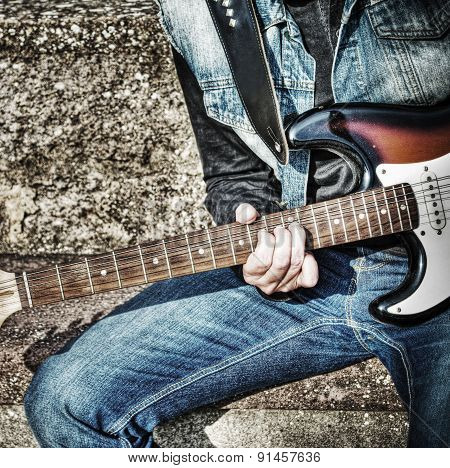 Close Up Of A Guitarist Playing On The Street In Hdr