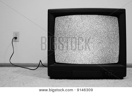 Television Plugged Into Wall With Static