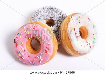 three delicious and tempting donuts with different flavor donuts and toppings isolated on white background in unhealthy nutrition and sugar and sweet cake addiction concept poster