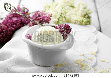 Beautiful composition with tasty ice cream and lilac flowers