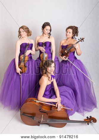 Quartet In Evening Dresses