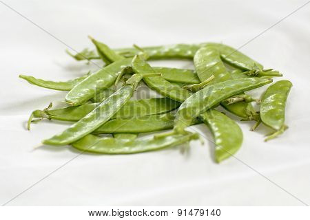 A pea is a most commonly green, occasionally purple or golden yellow, pod-shaped vegetable. The pea is most commonly the small spherical seed or the seed-pod of the pod fruit Pisum sativum. poster