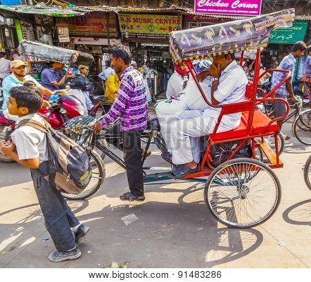 Indian Men Uses The Rickshaw For Transportation In Old Delhi