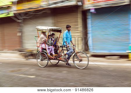 Rickshaw Rider Transports Passenger Early Morning