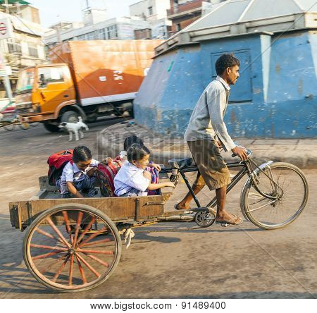 Father Transports His Children In A Cycle Rickshaw