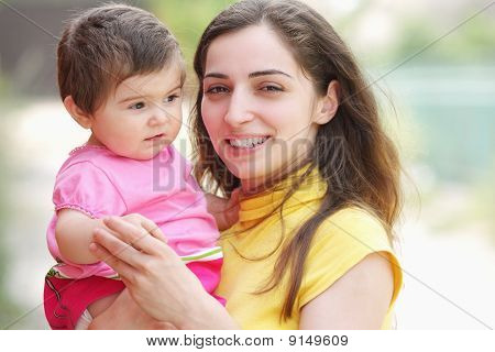 Smiling Mother With Child Closeup