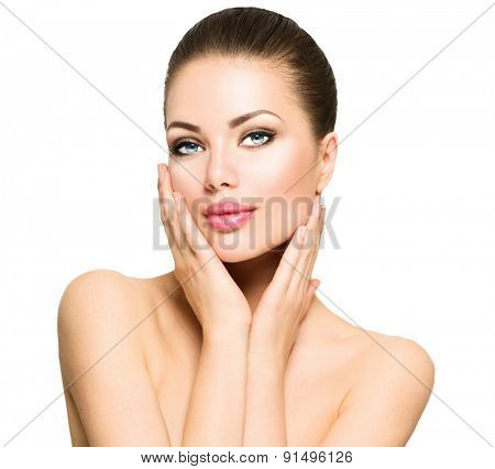 Beauty Portrait. Beautiful Spa Woman Touching her Face. Perfect Fresh Skin. Beauty brunette Model. Youth and Skin Care Concept. Studio shot. Isolated on white background