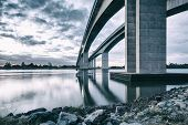 The Gateway Bridge (Sir Leo Hielscher Bridges) at sunset in Brisbane, Queensland, Australia. poster