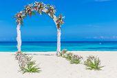beach wedding venue, wedding setup, cabana, arch, gazebo decorated with flowers, beach wedding setup poster