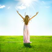 Beauty Girl enjoying nature on the field. Beautiful slim Woman Outdoor raising hands in sunlight rays. Full length Model portrait in long dress. Grassland, Sun Light. Free Lady. Health care concept poster