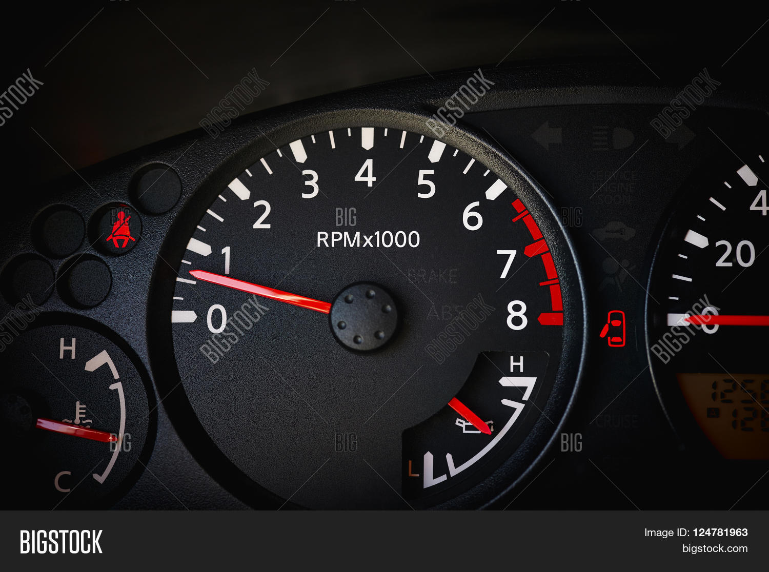 Dashboard Of A Car Showing Tachometer Partial Sdometer Temperature Gauge Battery Seat Belt Warning Light