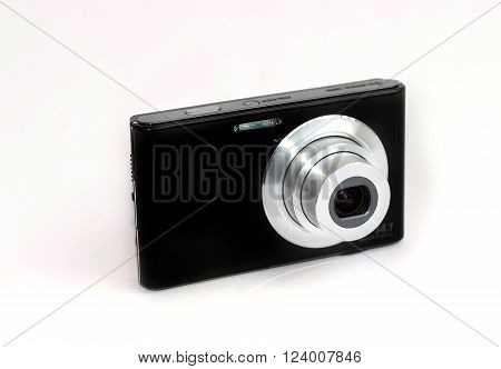 Compact digital camera isolated on white background. poster