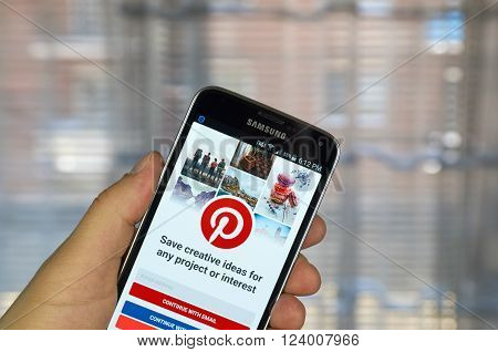 MONTREAL CANADA - MARCH 20 2016 - Pinterest application on android smartphone. Pinterest is a web and mobile application company that operates a photo sharing website