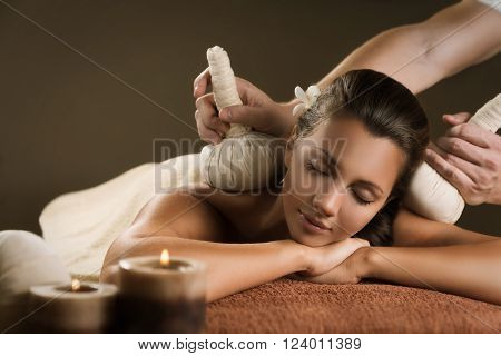 Massage with herbal balls. Luxury spa treatment