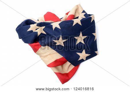 american flag crumpled and heart shape abstract on white background