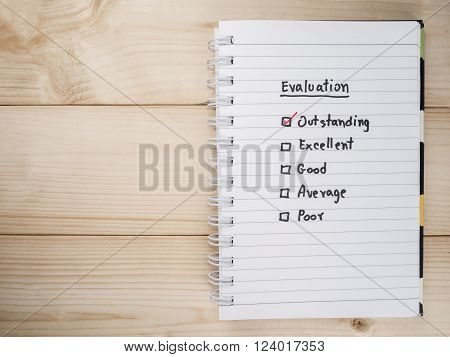 Performance Evaluation check box on white notebook (Business concept)