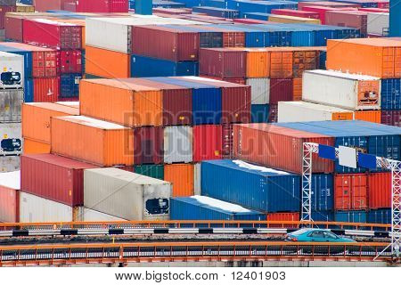 Containers waiting to be loaded in an intermodal yard poster