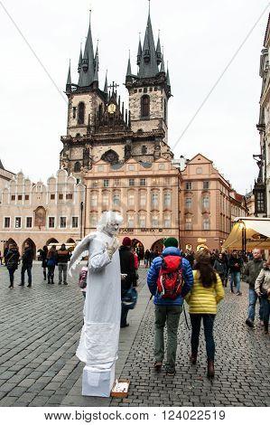 PRAGUE, CZECH REPUBLIC - FEBRUARY 13, 2016:  Human statue dressed as angel on square of Staromestske namesti