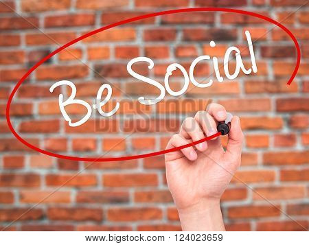 Man Hand Writing Be Social With Black Marker On Visual Screen.