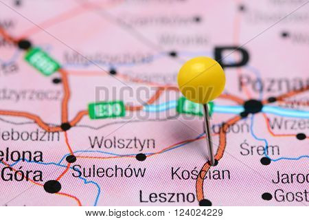Photo of pinned Koscian on a map of Poland. May be used as illustration for traveling theme.