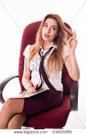 Woman complements Resume, girl sitting thinking about what to write, Girl  with pan and copybook, lady playing with hair