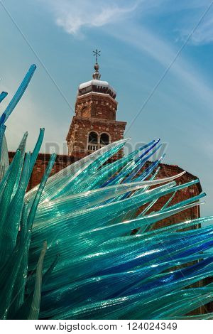 VENEZIA, ITALY - MAY 2015: Detail of Blue Murano Glass Sculpture in Murano with San Giacomo Church in Background Venice - Italy