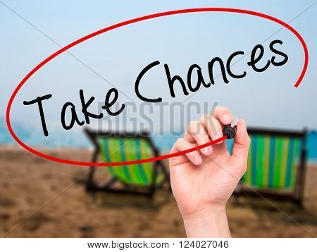 Man Hand Writing Take Chances With Black Marker On Visual Screen.