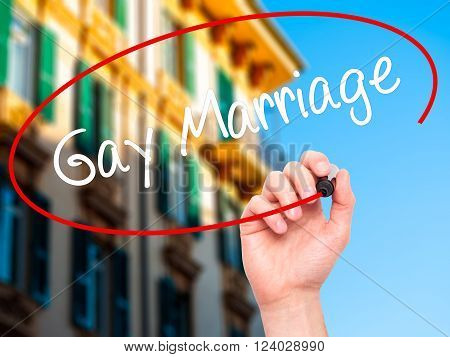 Man Hand Writing Gay Marriage With Black Marker On Visual Screen.