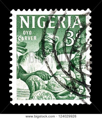 NIGERIA - CIRCA 1961: Cancelled postage stamp printed by Nigeria, that shows wood carver.
