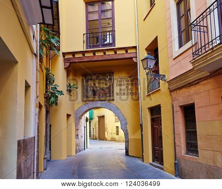 Valencia city old town in Spain. This arch is a door called Portal de Valldigna located in Carmen barrio neighborhood