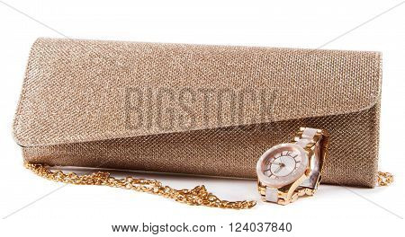 small fashion female bag and watch on white
