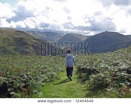 boy walking fell tops in the english lake district