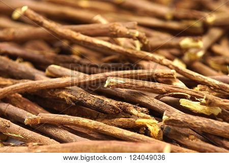 Licorice root lying on a white background