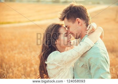 Young couple in love outdoor.Stunning sensual outdoor portrait of young stylish fashion couple posing in summer in field ** Note: Soft Focus at 100%, best at smaller sizes