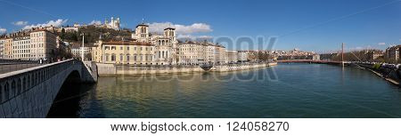 Lyon France - March 26 2016: Panoramic view of the old town of Lyon the Saone river and the Bonaparte bridge.